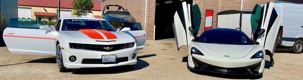 fancy cars in parking lot
