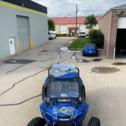 atv in parking lot with auto wrap